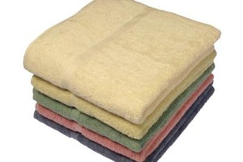 Use bath towels as yard goods for home decor projects.