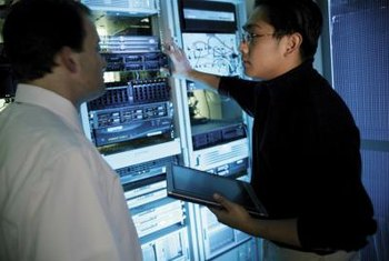 Information technology professionals are responsible for huge computer servers.