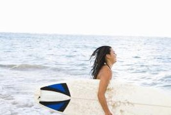 Knowing the correct way to hold your surfboard will help with staying out of the surf.
