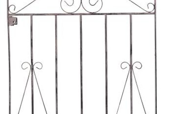 A sturdy gate hinge keeps the gate aligned.