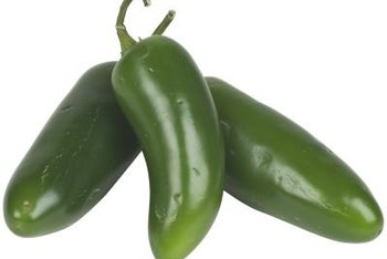 Hot jalapenos and sweet bell peppers can grow together.