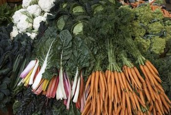 Carrots and dark-green vegetables contain provitamin A carotenoids.