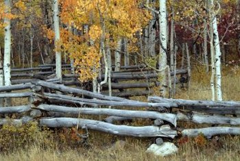 Stacked log fences stand alone without any posts or nails.