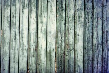 Seal your wooden fence to prevent weathering.
