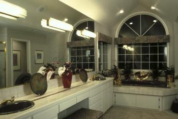 Bathroom with cove lighting above the mirror.