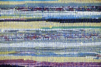 The visible interplay of warp and weft in a hand-loomed rug is dynamic.