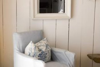 Wide-plank wood paneling looks lovely with an off-white paint.