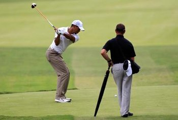 Tiger Woods' golf swing exemplifies the proper use of the right arm.