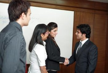 Watch your interviewers for cues to determine if you should shake hands.