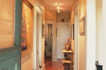 Make a hallway appear larger with light colors, bright illumination and streamlined furniture.