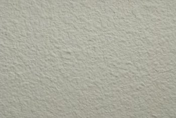 Remove heavy texture before resurfacing the wall.