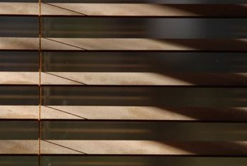 Wooden blinds operate on rope ladders.