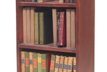 Secure a large bookshelf to a wall without causing damage to the bookshelf.