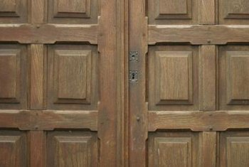 Remove old finishes and apply fresh sealer or stain to brighten up old mahogany doors.