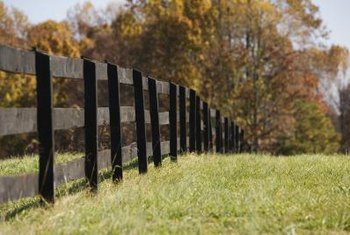 Simple fence designs work best for demarcating property lines.
