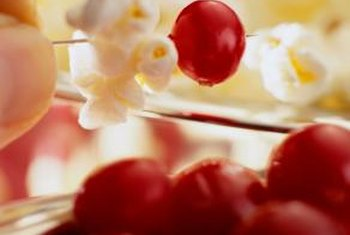 Popcorn and cranberries make inexpensive but festive and homey decorations.