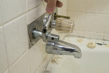 In some cases, disassembling the faucet can help locate a leak behind the wall.