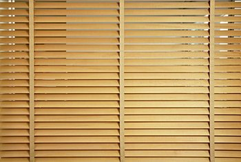 Faux wood blinds are a cost-effective way to achieve the look of real wood.