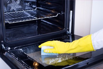 How to Get Burned Oil off of an Oven Bottom