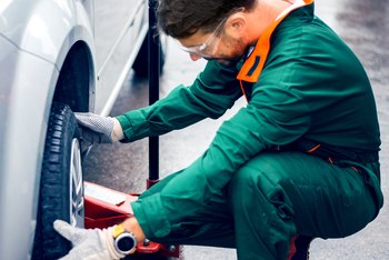 An automotive lube tech's job can be physically demanding.