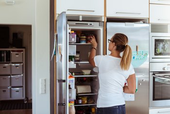 How to Stop a Refrigerator Door From Hitting the Wall When Opened