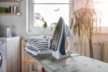 How to Remove Residue From the Bottom of a Steam Iron