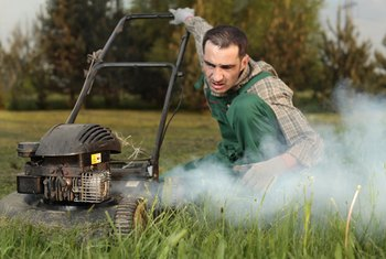 How to Rid Gas From an Oil Tank on a Lawnmower