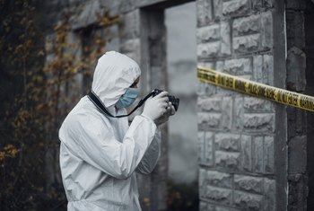 Forensic scientists go wherever they're needed to collect evidence to examine for crimes.