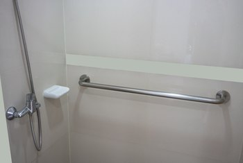 How to Attach a Grab Bar to a One Piece Tub and Shower Enclosure