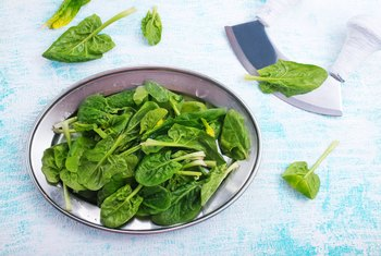 How Much Vitamin K in a Half Cup of Spinach in Micrograms?