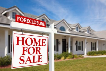 How Long Does a House Foreclosure Stay on Your Credit Record?