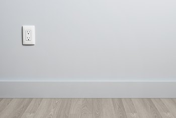 How to Move an Electrical Plug Up a Finished Wall