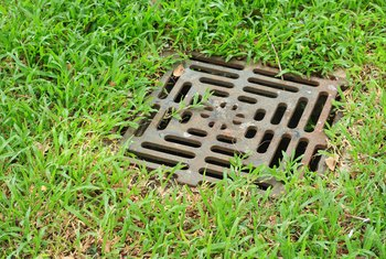 How to Put Drain Tile in Wet Yard Areas
