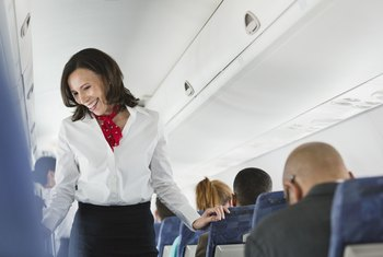 What Is the Difference Between a Stewardess & a Flight Attendant?