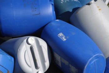 Recycled plastic barrels filled with air hold a lot of weight when placed in water.