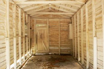 Metal or wood sheds are anchored from inside the shed to the flooring.