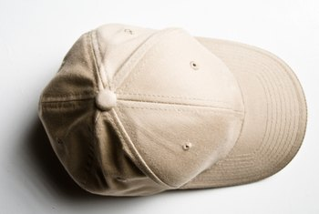 Clean a white baseball cap in the washing machine.