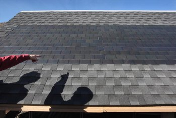 Solar roof tiles can blend in with standard asphalt shingles.