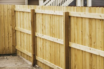 How to Protect Wooden Fence Posts From Rotting