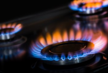 What Causes the Burner Flame on a Gas Stove to Be Yellow?