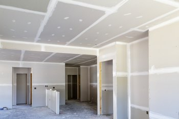 How to Attach Drywall to Plaster Walls