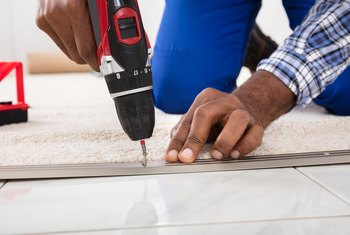 How to Install Self-Adhesive Vinyl Tile on a Concrete Floor After Removing Carpet