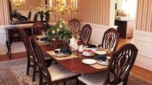<p>Chair rails break up a dining room wall for smart decorating.</p>