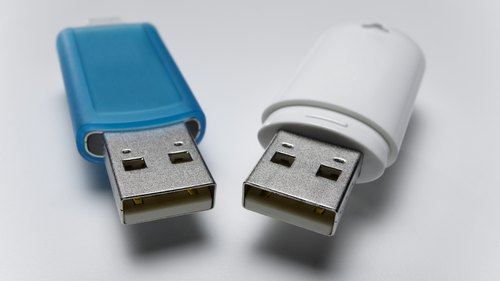 <p>Two devices can share one port with a USB hub.</p>