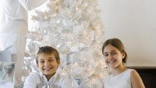 <p>A white Christmas tree provides an ideal background for black-and-white decorations.</p>