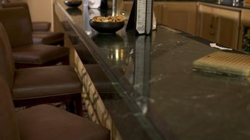 <p>Use adhesive to install floating granite tops.</p>